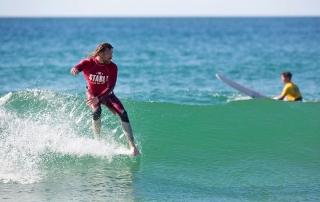 Ben Skinner surfing